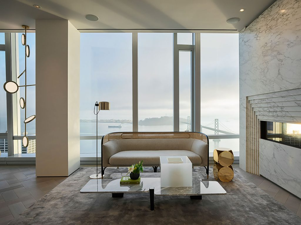 Grand Penthouse seating area with fireplace